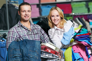 Young couple at clothes shopping