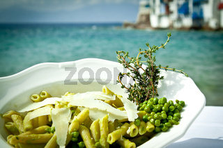 Pasta with peas and thyme by the beach.
