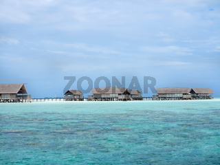 Cottages on a pristine white beach