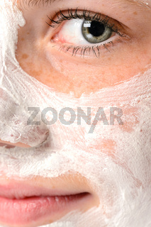 Smiling girl moisturizer facial face mask eye