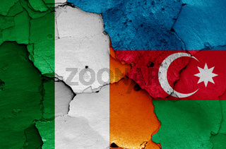 flags of Ireland and Azerbaijan painted on cracked wall