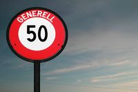 Road sign speed limit 50 at dusk
