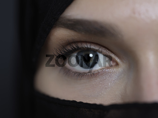 Portrait of muslim woman wearing niqab and traditional arabic clothes or abaya