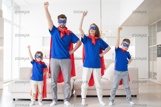 Family of superheroes at home