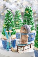 Christmas card with a teddy bear on a sled.