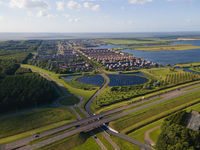Modern innovative residential area in Almere, along the waterside, including solar panel field. The Netherlands, Flevoland.