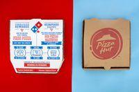 Calgary, Alberta. Canada. May 17, 2021. A Domino's and Pizza Hut Pizza Boxes. Concept: Top Pizza Companies