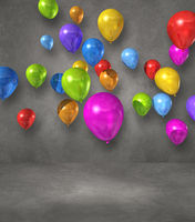 Colorful balloons group on a grey wall background
