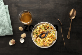 Seafood pasta. Tagliolini with mussels, shrimps, clams and squid rings