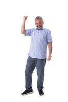 Senior man cheering his success