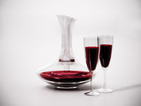Wine decanter and glasses with red wine. 3D illustration