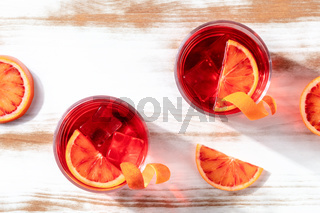 Cocktails with blood orange juice, overhead shot with copy space