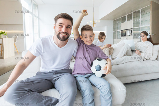 Father and son watching soccer