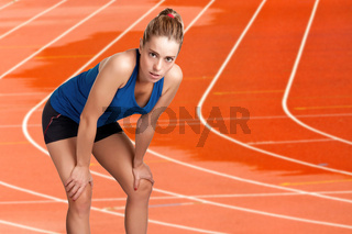 Female Jogger Resting After Running on an Athletics Running Track
