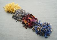 Floral herbs - dried marigold, lavender, rose and cornflower petals as ingredients for cooking