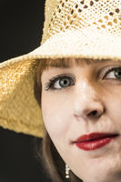 Woman with yellow straw hat