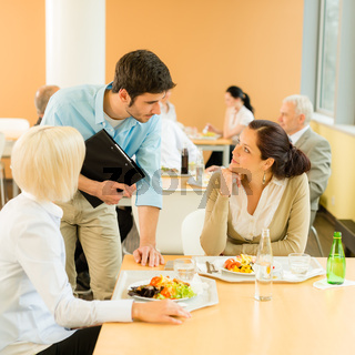 Lunch break office colleagues eat salad cafeteria