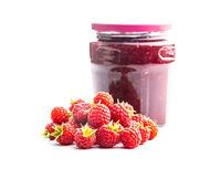 Ripe red raspberries and jam