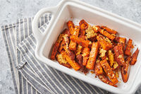 Sweet potato with cheese backed in bowl on grey background