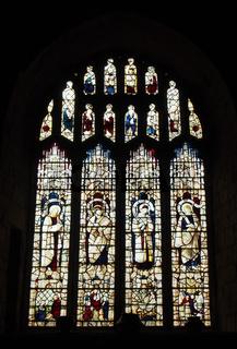 19th century stained glass window dedicated to saints in the medieval cartmel priory in cumbria