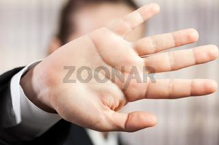 Hand hiding face