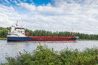 Cargo ship on the Kiel Canal near Hochdonn, Schleswig-Holstein, Germany