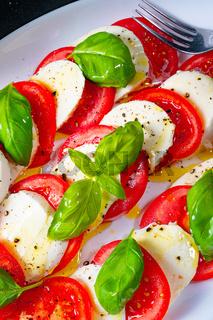 Tomato with mozzarella and basil