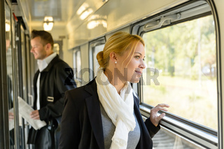 Woman looking out the train window traveling