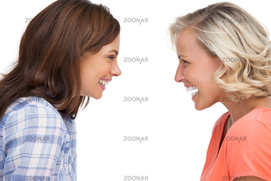 Two friends looking to each other and laughing