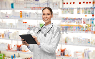 happy female doctor with tablet pc and stethoscope