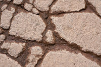 Cracks in the surface of the pavement of a weathered road