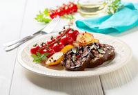 Eggplant steaks with vegetables.