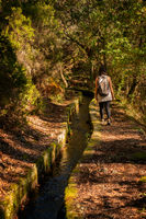 Caucasian woman hiking on a trail in nature landscape fall landscape with a river