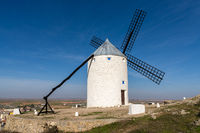 A view of traditional whitewashed Spanish windmills in La Mancha on a hilltop above Consuegra