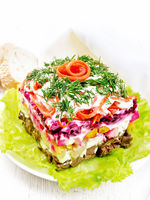 Salad with beef and vegetables on white wooden board