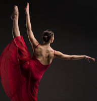 Beautiful girl dancing gracefully rearview