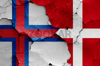 flags of Faroe Islands and Denmark painted on cracked wall