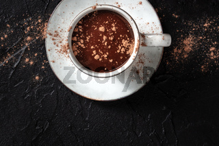 Hot chocolate and cocoa powder, a still life on a black background