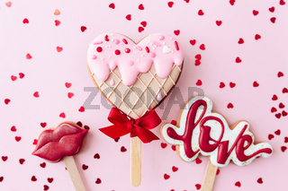 Gingerbread cookies love, lips, heart ice cream. Valentine card. Pink background