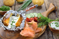 Backed potato with sour cream and salmon