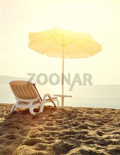 Beach loungers at sunrise