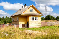 Rural wooden house in russian village in summer day