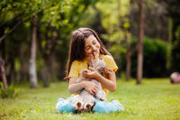 the cute little girl with Yorkshire terrier dog in the backyard