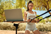 Young woman blogger records training perform workout outdoor