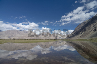 Mountain Reflections, Yarab Tso lake at Panamik near Nubra Valley, Ladakh, India