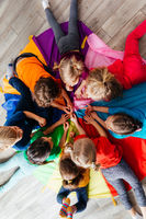 Happy kids laying on a floor in circle