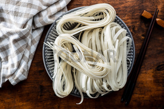 Dried white rice noodles. Raw pasta. Uncooked noodles.