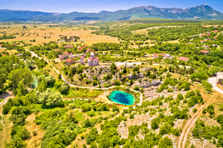 Dalmatia hinterland. Cetina river source and Orthodox church aerial view