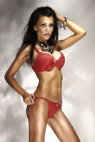 Photo of sexy brunette woman posing in red lingerie and amazing jewellery
