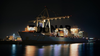 Container terminal in the port of Hamburg in the evening